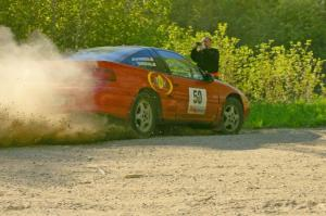Doug Davenport snaps a shot of the Steve Gingras / Nick Johannes Mitsubishi Eclipse at a 90-left on SS2.