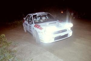 Dave Hintz / Rick Hintz reapply the throttle at a right-hander at the SS8, Kabekona, spectator point in their Subaru WRX.