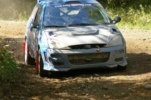 Adam Boullion / Phil Boullion Ford Focus at an uphill right-hander on SS13.