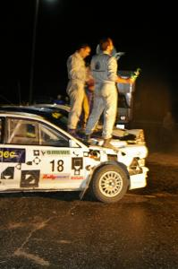 Matt Iorio and Ole Holter stand atop their second place Subaru Impreza after the champagne spray.