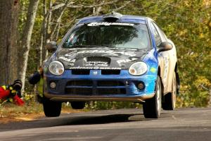 Cary Kendall / Scott Friberg catch minor air over the midpoint jump on Brockway 1 in their Dodge SRT-4.